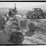 "Very cool, totally unrelated photograph.  Ansel Adams:  ""Tractor Repair at Manzar Japanese Internment Camp"""