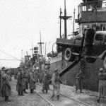 Finnish landing troops for Tornio are being loaded onboard in Oulu Toppila harbour during Lapland War in Finland. The truck is equipped with a wood gas generator