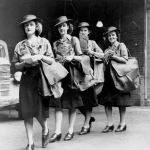 Postwomen with their mail bags and bundles of mail, Brisbane February 1943.